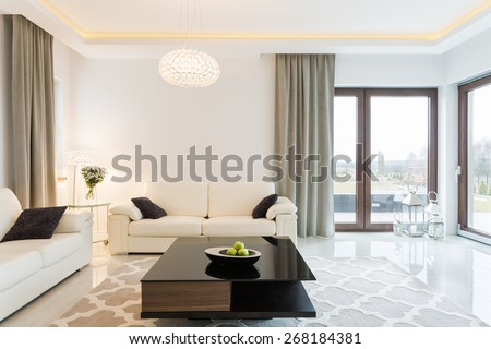 Cream sofa in luxury designed sitting room - stock photo