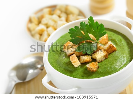 Cream soup and dried crusts, studio shot, white background, isolated