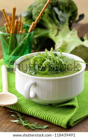 Cream soup  broccoli with arugula greens in a white bowl