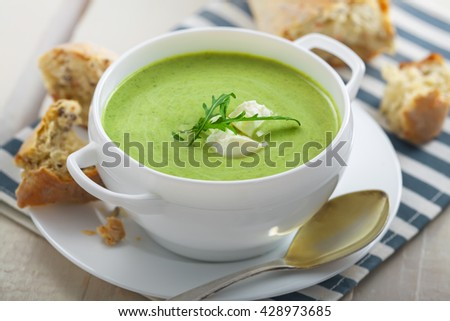 Cream soup made of broccoli on table. Traditional European food. - stock photo