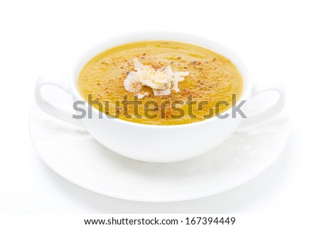 cream soup of yellow lentils, isolated on white - stock photo