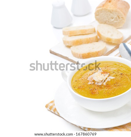 Cream soup of yellow lentils with vegetables, isolated on white - stock photo