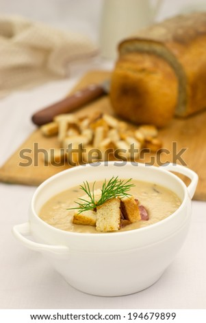 Cream soup with croutons - stock photo