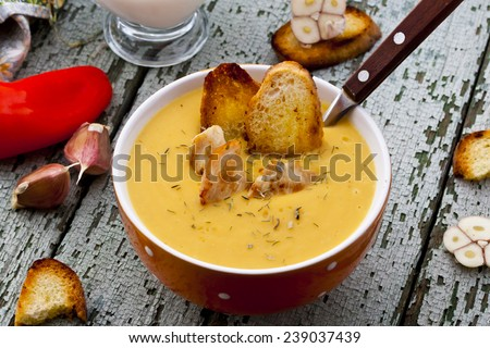 cream-soup with lentils, chicken, thyme and croutons - stock photo
