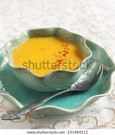 Cream-soup with pear. Selective focus on the soup in plate. - stock photo