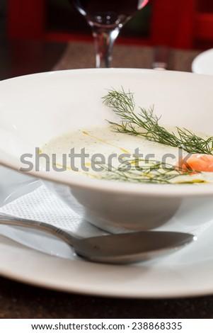 Cream soup with salmon - stock photo