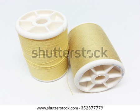 Cream thread isolated on white background