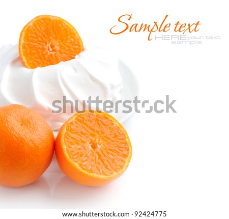 Cream with tangerines on a white background - stock photo