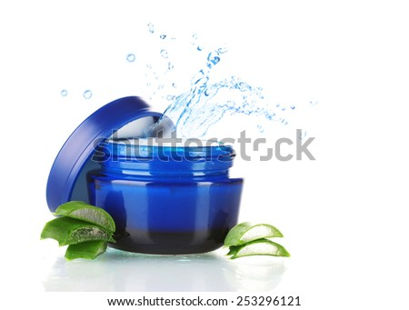 Cream with water splashing and fresh sliced cucumber isolated on white - stock photo