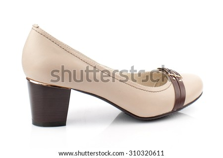 Cream women shoe isolated on white background.