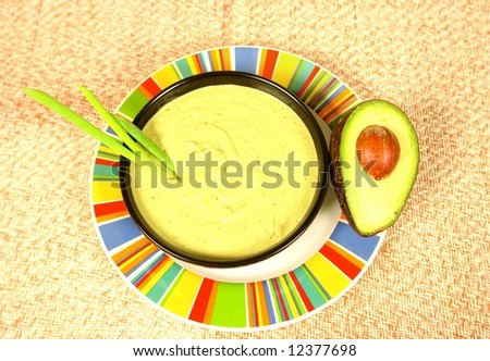Creamy avocado cream soup - stock photo