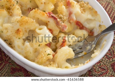 Creamy baked macaroni and cheese with sun-dried tomatoes, provolone cheese, and mozzarella cheese, then topped with bread crumbs.
