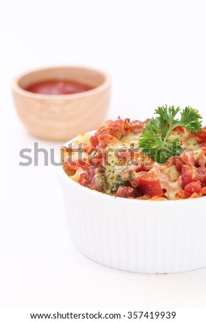 Creamy baked pasta with bacon and cheese on white background - stock photo
