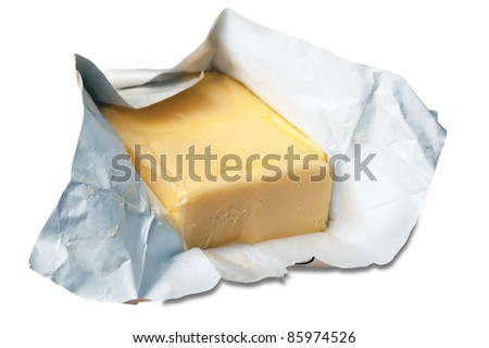 Creamy butter in its unwrapped foil paper. Isolated on white + Clipping Path - stock photo