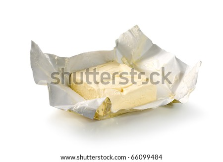Creamy butter in its unwrapped foil paper. Isolated on white (Path) - stock photo