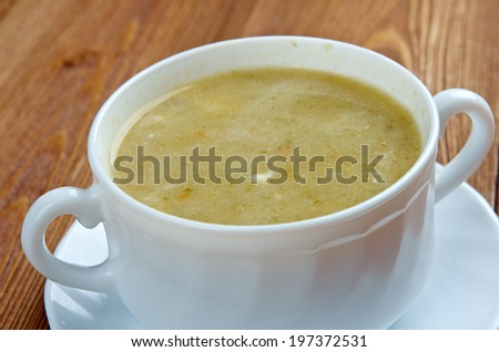 Creamy cabbage and sorrel soup with sour cream - stock photo