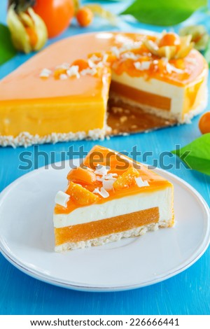 Creamy cake with coconut, mango and persimmon