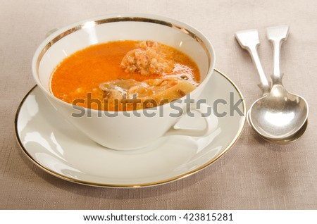 creamy carp soup with sour cream in a double handled soup bowl - stock photo