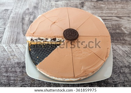 Creamy cheesecake with chocolate cookies and cream biscuits - stock photo