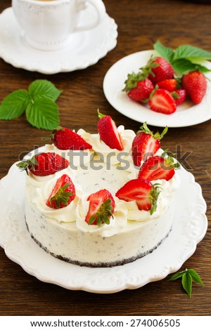 Creamy cheesecake with chocolate Oreo biscuits and strawberries. - stock photo