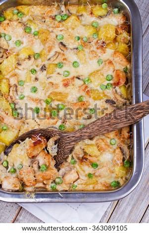 Creamy Chicken, Potato  and Mushrooms Casserole. View from above, top studio shot  - stock photo