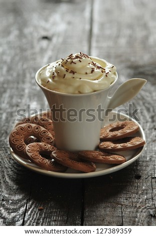 Creamy coffee with cookies - stock photo
