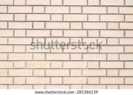 creamy color brick wall texture as background, close up, horizontal - stock photo