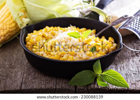 Creamy corn with cream and grated parmesan - stock photo