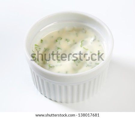 creamy dip with herbs in a bowl - stock photo