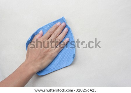 creamy fabric cleaning with a Microfiber Cloth - stock photo