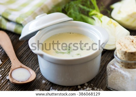 Creamy fennel soup with fresh herbs - stock photo