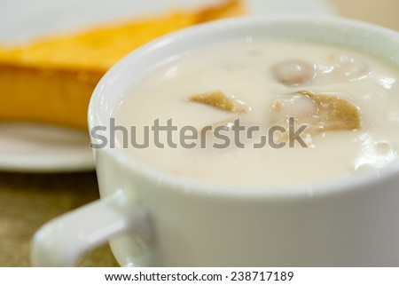 Creamy hot basil musroom soup served with chicken cutlet - stock photo
