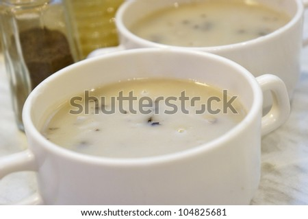 Creamy hot basil musroom soup served with chicken cutlet and parsley leaf. (shallow depth of field) - stock photo