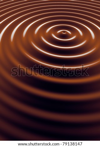 Creamy liquid chocolate drops form swirls and ripples in a bowl. Great image background or texture for use on a chocolate milk, cereal or dessert packaging design.