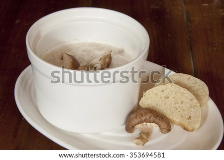 creamy mushroom soup with bread - stock photo