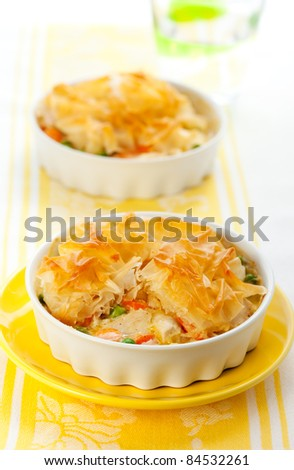 Creamy mustard chicken pot pie with vegetables  and filo - stock photo