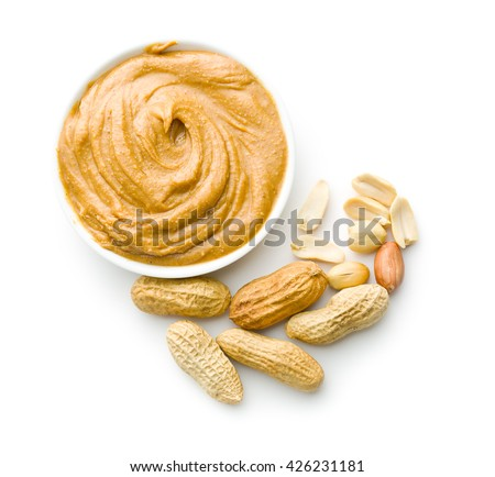 Creamy peanut butter and peanuts  isolated on white background. Spreads peanut butter in the bowl. - stock photo