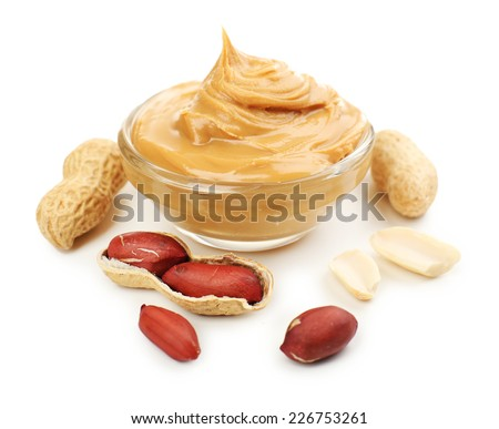Creamy peanut butter in bowl, isolated on white - stock photo