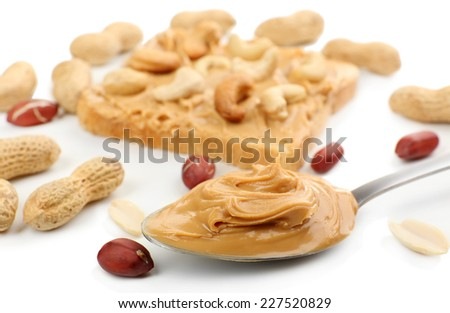 Creamy peanut butter in spoon, close-up - stock photo