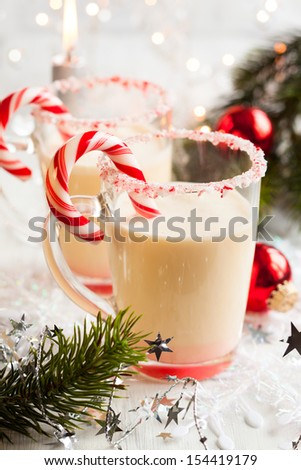 Creamy Peppermint Punch with candy cane - stock photo