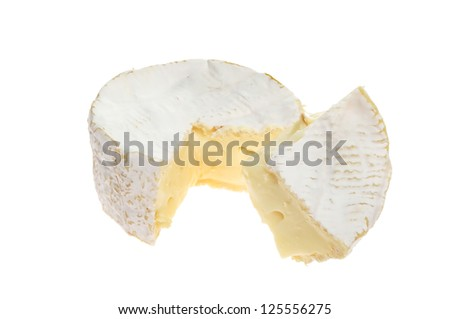 Creamy ripe camembert cheese with a section cut out
