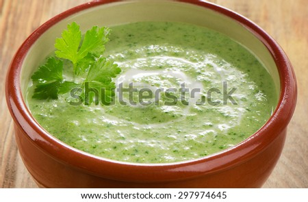 Creamy soup on a wooden table. Selective focus