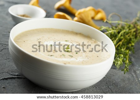 Creamy soup with chanterelle and thyme - stock photo