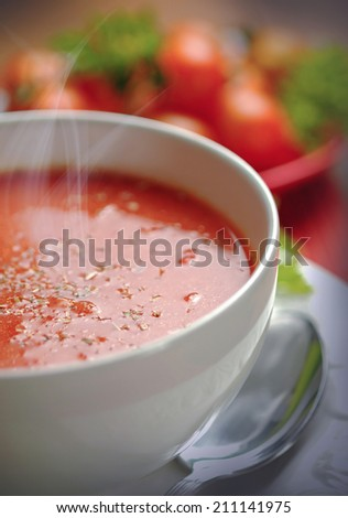 Creamy tomato soup in white bowl - stock photo
