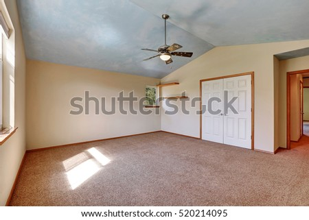 Creamy Tones Empty Room With Closet And Shelves, Vaulted Ceiling And Carpet  Floor . Northwest