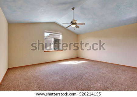 Creamy tones empty room with vaulted ceiling and carpet floor . Northwest, USA