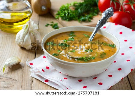 Creamy vegan tomato soup with garlic and rice - stock photo