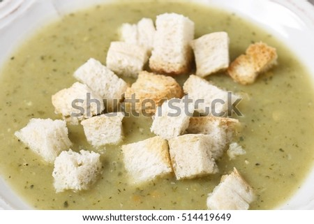 Creamy vegetable soup with croutons