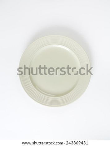 creamy white plate on white background