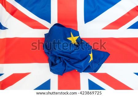 Creased Flag of European Union on the Flag of the United Kingdom - stock photo